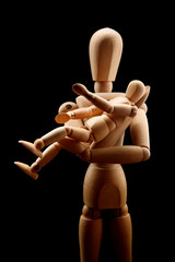 wooden man with wooden child