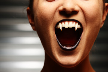 Close up of a vampire woman's mouth
