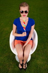 Girl with sunglasses and a lollipop