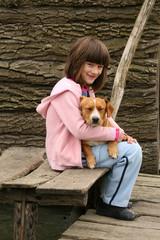 girl holding puppy