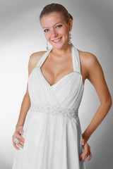 Beautiful woman wearing luxurious wedding dress studio