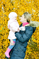 portrait of woman with toddler in autumnal nature