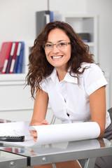 Closeup of smiling businesswoman wearing eyeglasses