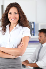 Beautiful woman standing in the office