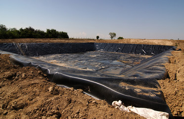 Empty new landfill with plastic isolating layer