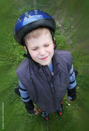 Closed eye rollerboy in blue helmet