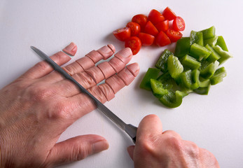 Chopping fingers on cutting board