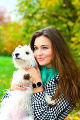 portrait of beautiful girl with her dog