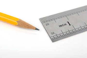steel ruler with pencil