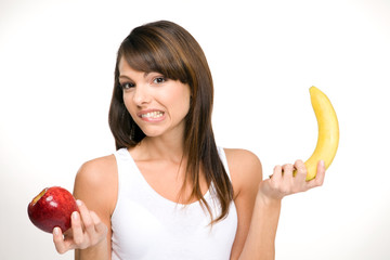 Expressive woman holding fruits