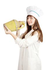 female cook holding large bottle