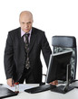 Young businessman standing at the table in his office.