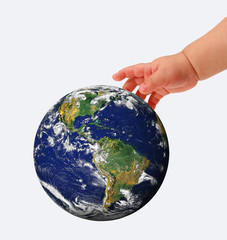 The globe in hands of the child,isolated on a white