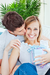 Pleased woman receive a present from her boyfriend