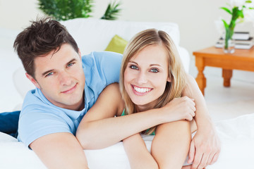 Smiling beatiful couple sitting on a sofa