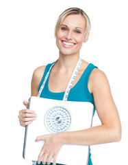 Caucasian young woman holding a weight scale