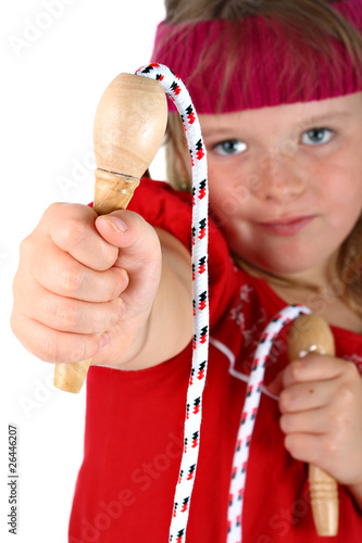 Small girl handing you her jump rope isolated on white