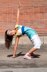 Beautiful teenage girl dancing hip-hop