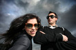 Cool young couple over dramatic cloudy sky