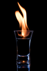 Flaming vodca, and lime over black