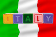 italy and flag in toy block letters
