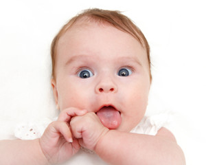 Portrait of astonished baby