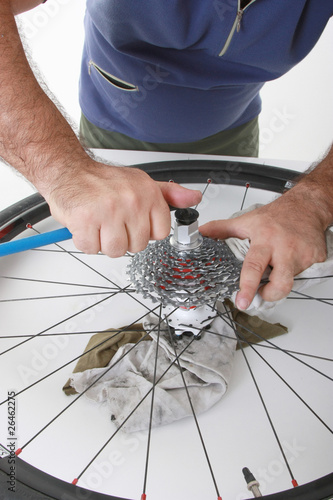 cyclist/biker taking care of his bike