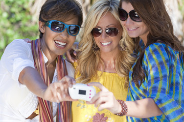 Three Women Taking Pictures of Themselves on Digital Camera
