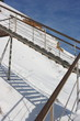 Stairs with landing against a snow slope