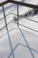 Stair railing in winter