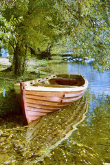 Boat near the shore of the river in the autumn