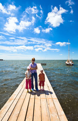 Family on wooden pier
