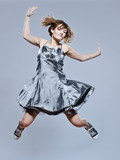 beautiful young girl with prom dress jumping happy poster