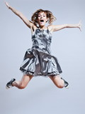 beautiful young girl with prom dress jumping screaming happy poster