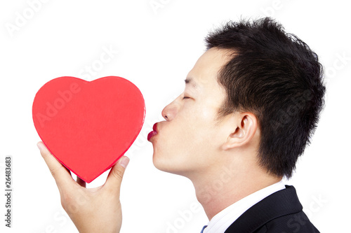 young man kissing red gift box of love