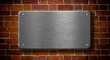 metal plate with rivets on brick wall background