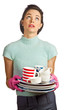 Young beautiful housewife with pile of dirty dishes