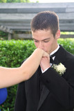 Prom Boy Kissing Girlfriend's Hand