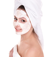 Girl with clay facial mask. Isolated.