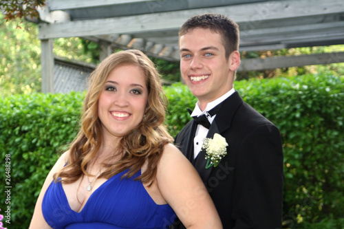 Young Prom Couple In Yard