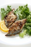 fried flounder with lemon and lettuce poster