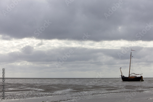vintage sailing ship at low tide