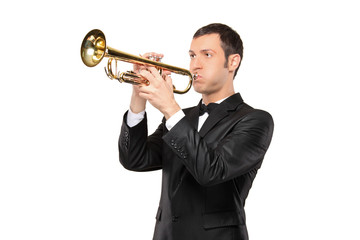 Man in a suit playing a trumpet