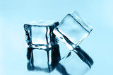ice cubes on black glossy background