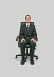 Businessman sitting in office chair