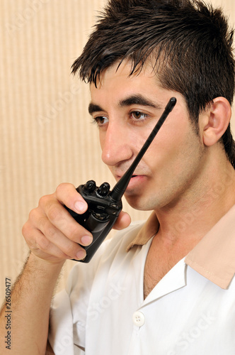 Portrait of a young housekeeper with walkie-talkie.