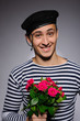 Funny emotional romantic sailor man holding rose flowers prepare