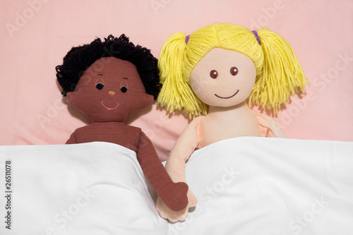 Interracial couple concept , with handmade rag dolls