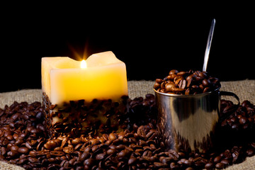 cup wtih coffee bean and candle