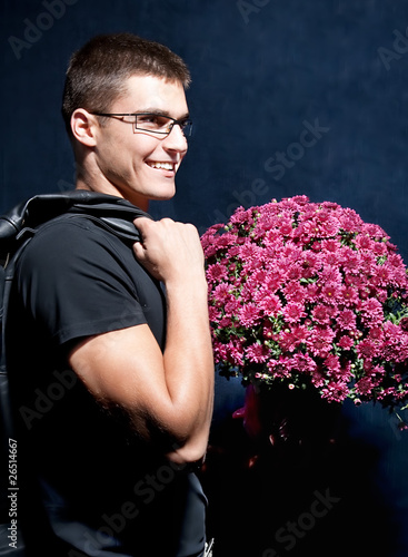 Romantic man holding big bouquet of flowers